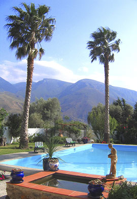 View across pool and garden to the Lugar Hills, Alpujarra: Private Andalucia villa with swimming pool for weekly rentals or B&B stays, walking Alpujarras